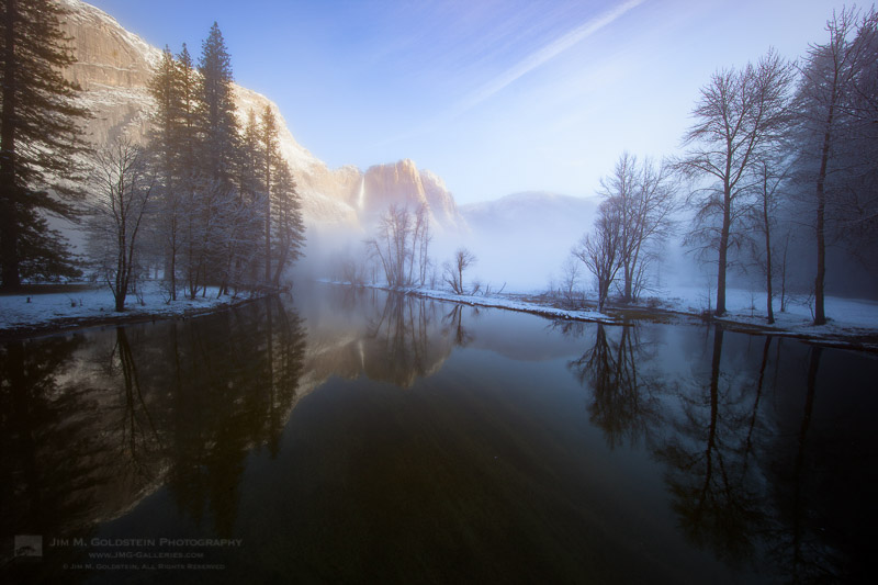 Morning light on Yosemite Falls amidst rising winter fog - Yosemite National Park
