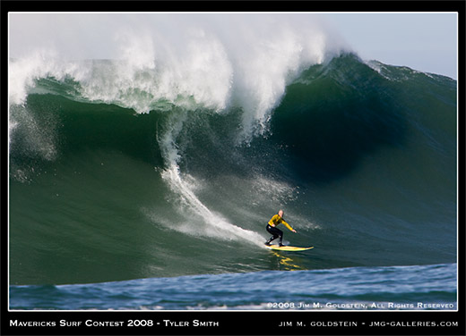 Tyler Smith drops in on a monster wave at Mavericks Surf Contest 2008 photo by Jim M. Goldstein