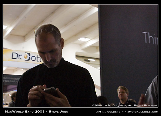 Steve Jobs at MacWorld Checking His iPhone with Robert Scoble lurking in the background