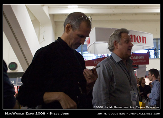 Steve Jobs at MacWorld Checking His iPhone