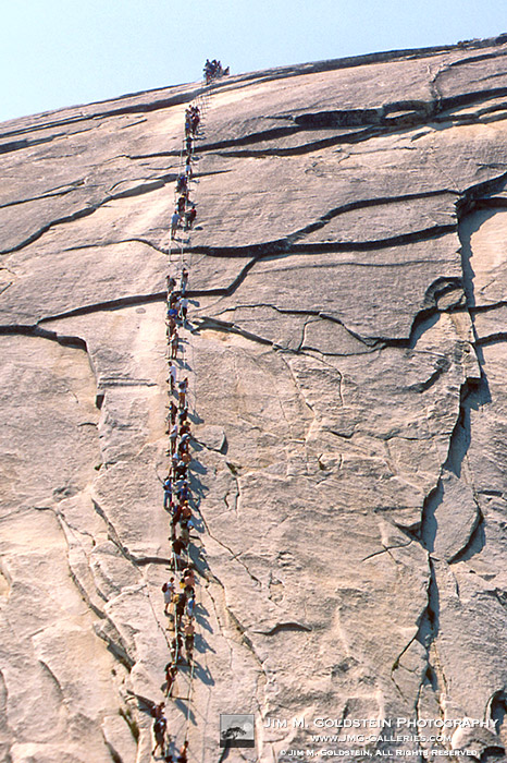 Hikers Climbing the Cables on Half Dome - Yosemite, California  (zoom)